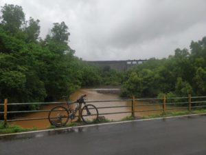 Cycle with Panshet Dam in background